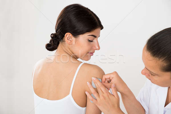 Stock photo: Happy Woman Getting Electrodes Therapy