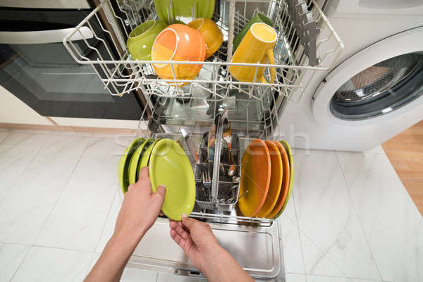 Person Hands Putting Plate In Rack Stock photo © AndreyPopov