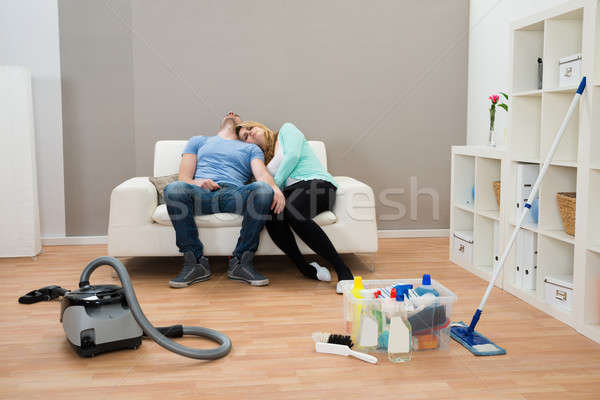 Kimerült pár kanapé nappali pihen ház Stock fotó © AndreyPopov