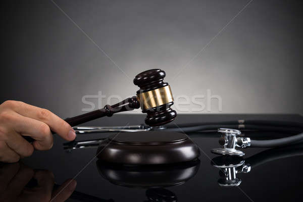 Close-up Of Hands With Gavel And Stethoscope Stock photo © AndreyPopov