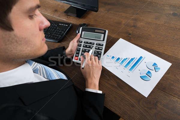 üzletember pénzügyi adat számológép közelkép asztal Stock fotó © AndreyPopov