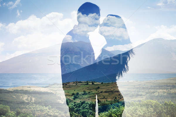 Superimposed Of Couple Against Scenic Backdrop Stock photo © AndreyPopov