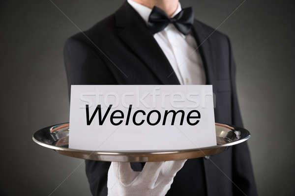 Garçom prato bem-vindo texto papel Foto stock © AndreyPopov