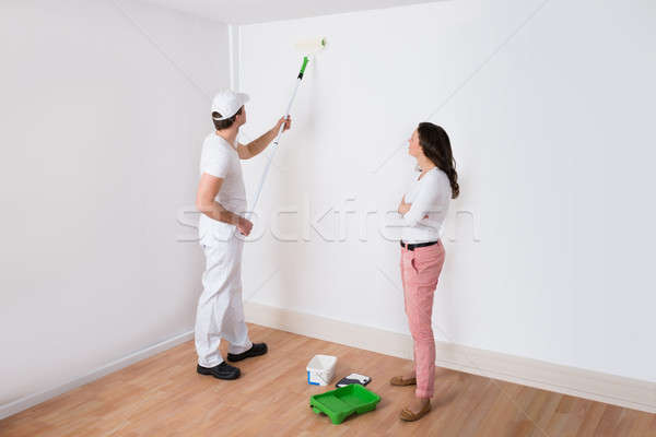 Housewife Looking At Painter Painting Stock photo © AndreyPopov