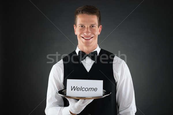 Pincér tart tányér üdvözlet szöveg kártya Stock fotó © AndreyPopov