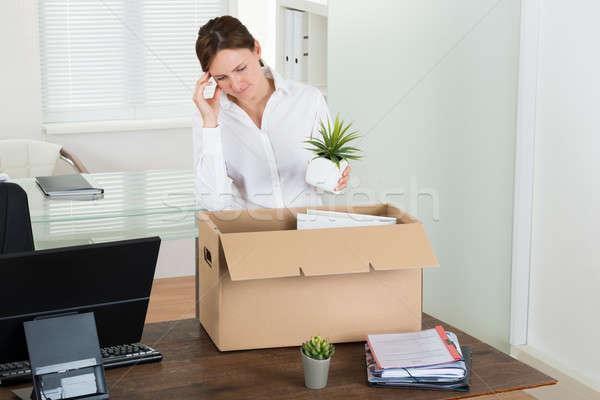 Businesswoman Putting Her Belongings In Box Stock photo © AndreyPopov