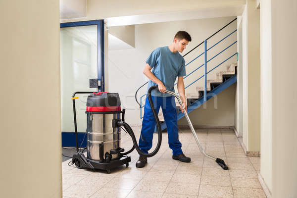 Male Worker Cleaning With Vacuum Cleaner Stock photo © AndreyPopov
