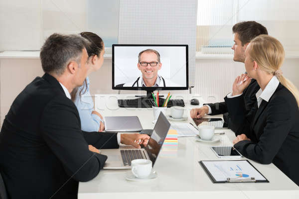 Businesspeople Videoconferencing With Doctors Stock photo © AndreyPopov