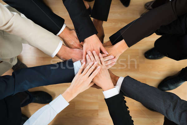 Business Team Stacking Hands On Table Stock photo © AndreyPopov