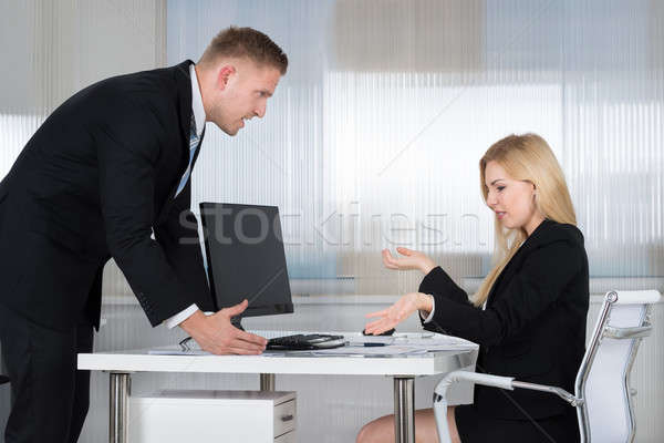 Businessman Blaming Employee In Office Stock photo © AndreyPopov