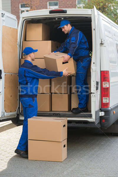 Delivery Men Unloading Cardboard Boxes From Truck Stock photo © AndreyPopov