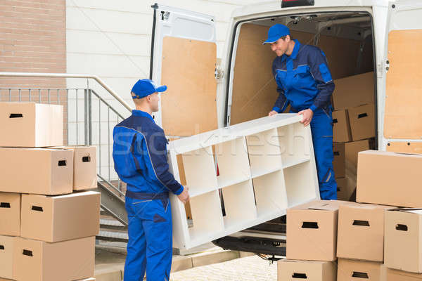 Movers Unloading Furniture From Truck Stock photo © AndreyPopov
