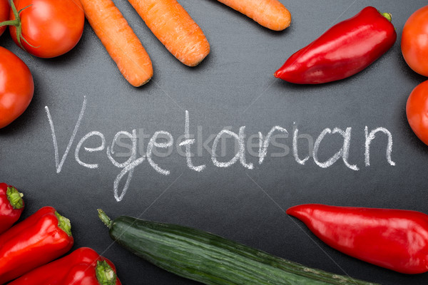 Vegetarian Written Amidst Fresh Vegetables On Blackboard Stock photo © AndreyPopov