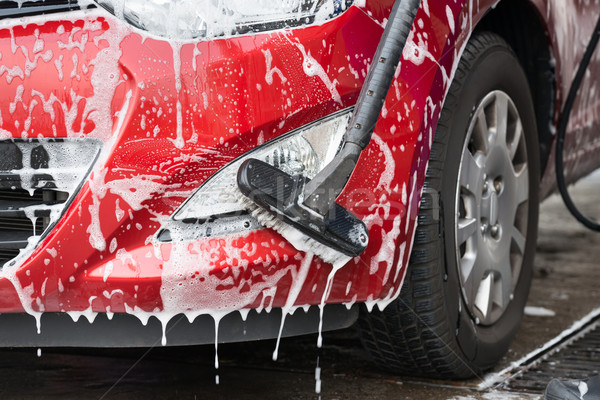 Car Being Washed By Scrubbing Brush Stock photo © AndreyPopov
