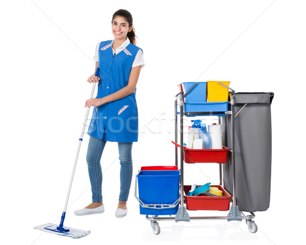 Happy Female Janitor Mopping By Trolley On White Background Stock photo © AndreyPopov