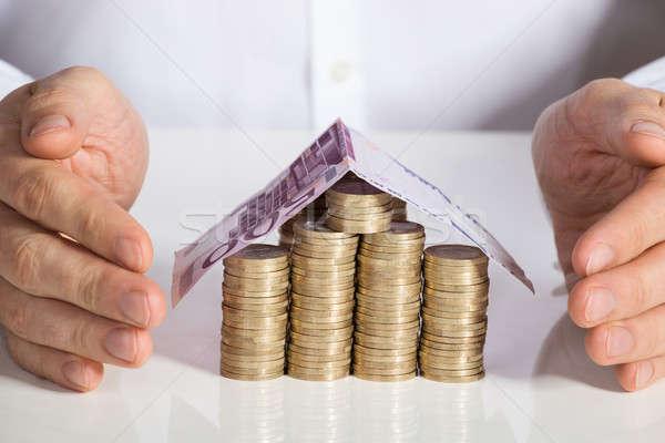 üzletember ház érmék bankjegy irodai asztal iroda Stock fotó © AndreyPopov