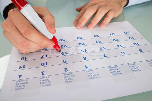 Imprenditore data calendario primo piano rosso marcatore Foto d'archivio © AndreyPopov