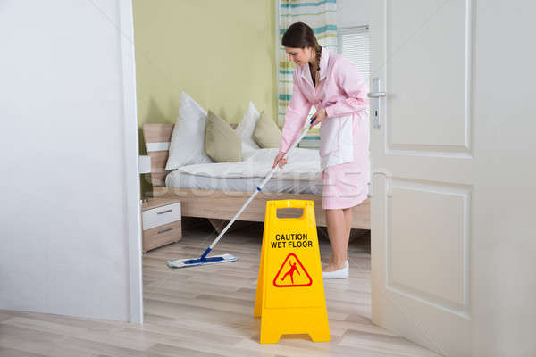 Female Housekeeper Cleaning Floor With Mop Stock photo © AndreyPopov