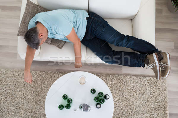 Man Taking A Nap On Sofa At Home Stock photo © AndreyPopov