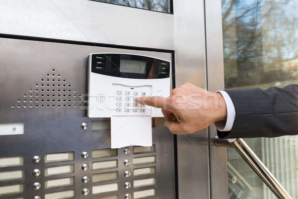Close-up Of Businessperson Entering Code In Security System Stock photo © AndreyPopov