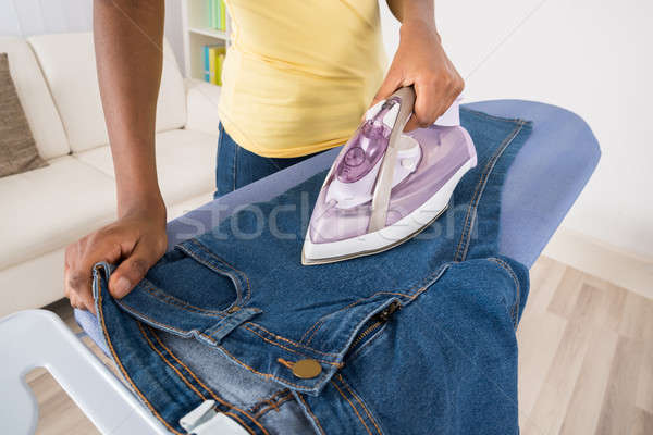 Woman Ironing Jeans Stock photo © AndreyPopov