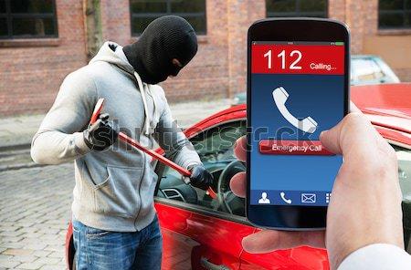 Persoon hand mobiele telefoon inbreker veiligheid Stockfoto © AndreyPopov