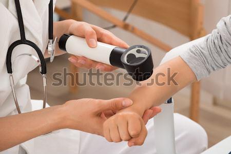 Doctor Examining Skin Of Child Patient Stock photo © AndreyPopov