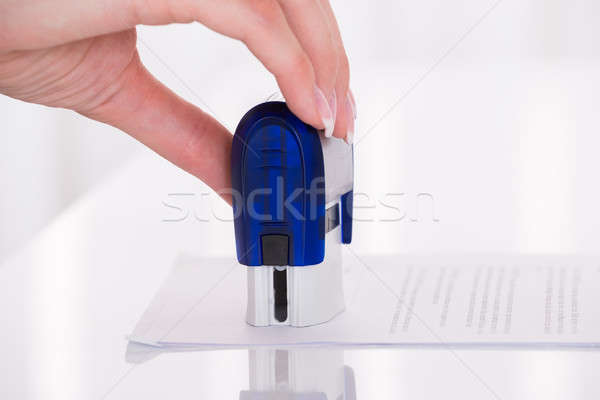 Person's Hand Stamping Document Stock photo © AndreyPopov