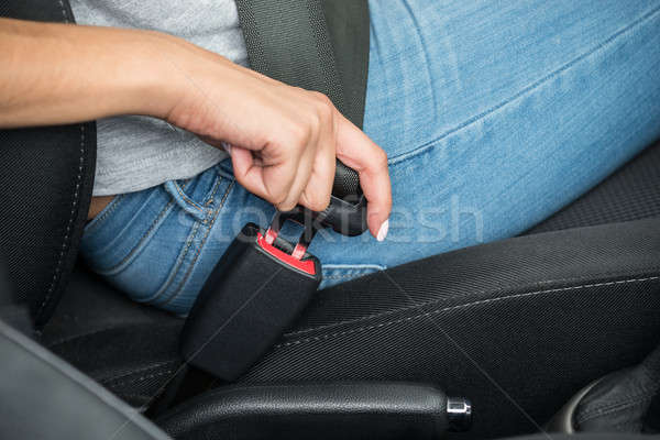 Female's Hand Sitting Inside Car Fastening Seat Belt Stock photo © AndreyPopov