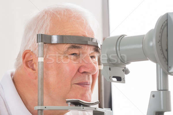 Man Checking Eyesight In Clinic Stock photo © AndreyPopov