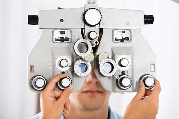 An Optometrist Adjusting Phoropter For Patient Stock photo © AndreyPopov