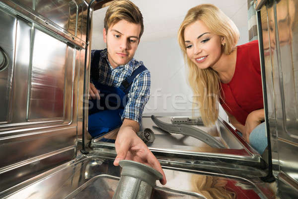 Male Worker Repairing Dishwasher In Kitchen Stock photo © AndreyPopov