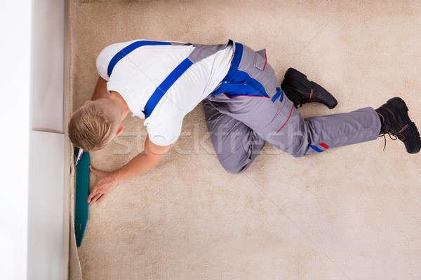 Craftsman Fitting Carpet On Floor Stock photo © AndreyPopov