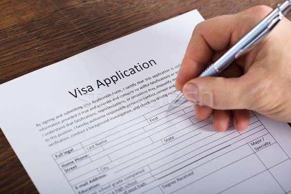 Personne remplissage visa demande forme Photo stock © AndreyPopov