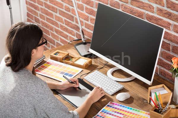 Female Graphic Designer Using Graphic Tablet Stock photo © AndreyPopov