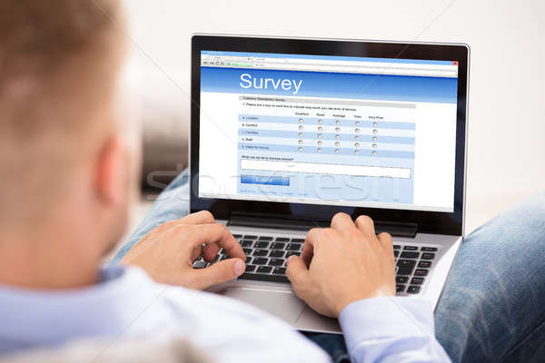 Man Filling Survey Form On Laptop Stock photo © AndreyPopov