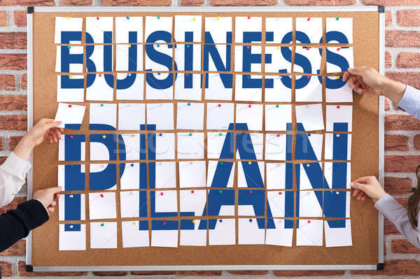 Business Plan Written On Paper Notes Stock photo © AndreyPopov
