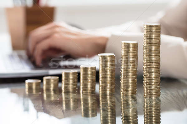 Stack Of Increasing Coins On Office Desk Stock photo © AndreyPopov