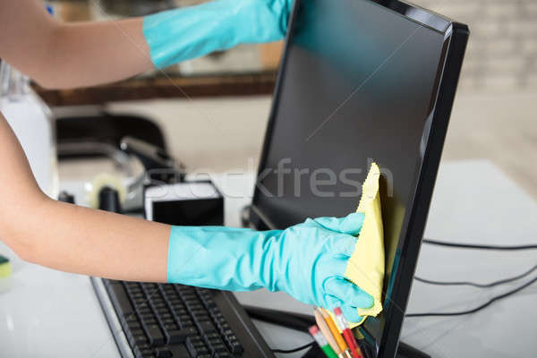 Woman Cleaning Desktop Screen With Rag Stock photo © AndreyPopov
