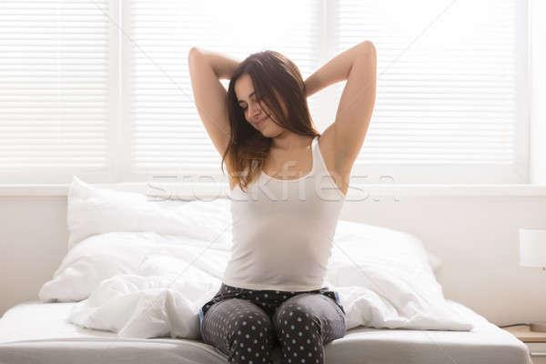 幸せ 眠い 女性 ベッド 笑みを浮かべて 小さな ストックフォト © AndreyPopov