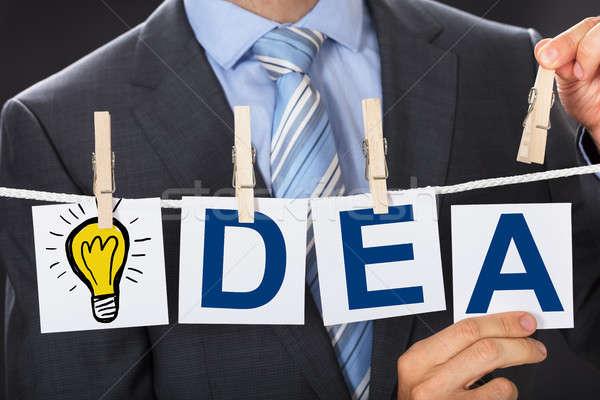 Businessman Pinning IDEA Cards On Clothesline Stock photo © AndreyPopov