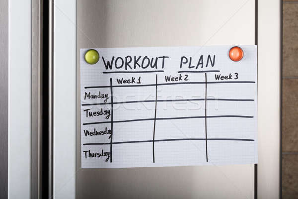 Workout Plan Paper Attached With Magnetic Thumbtacks Stock photo © AndreyPopov