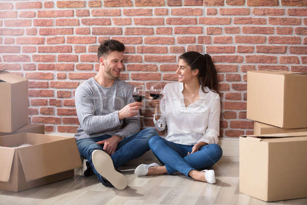 Couple Toasting Wine Glasses In Their New Home Stock photo © AndreyPopov
