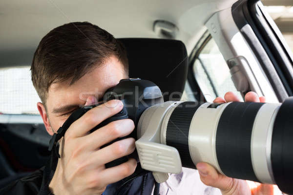 Private Detective Photographing With Slr Camera Stock photo © AndreyPopov