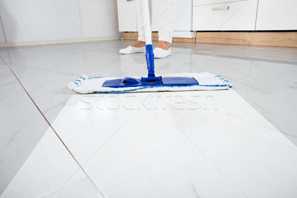 Low Section Of Person Wiping Floor Stock photo © AndreyPopov