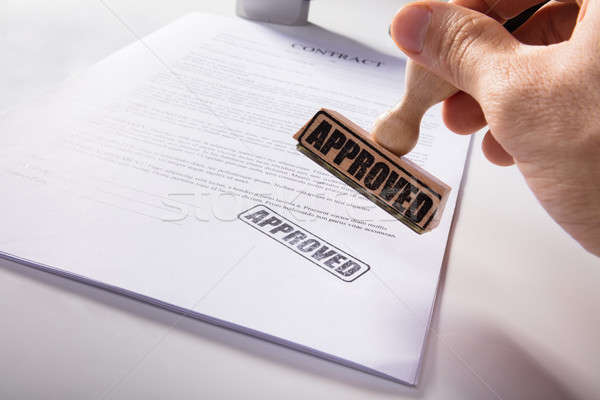 Person's Hand Stamping Approved On Contract Paper Stock photo © AndreyPopov