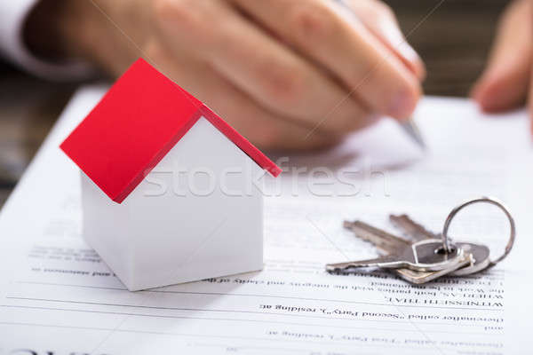 Businessperson Signing House Contract Stock photo © AndreyPopov