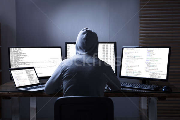 Hacker Using Multiple Computers For Stealing Data Stock photo © AndreyPopov