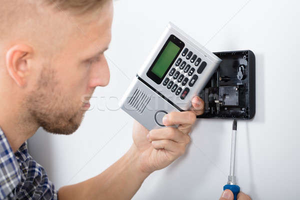 Male Technician Installing Security System Stock photo © AndreyPopov