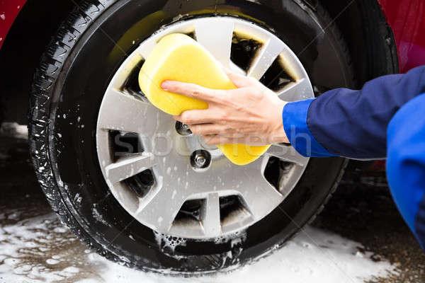 работник рук стиральные автомобилей колесо желтый Сток-фото © AndreyPopov